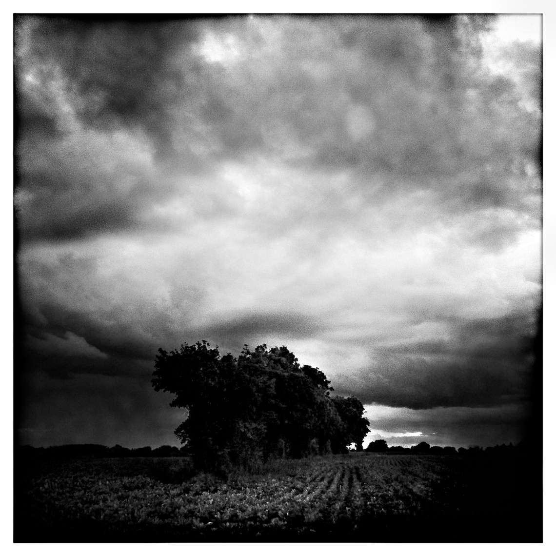 Jon Wyatt Photography - clouds and farm fields, Suffolk. Hipstamatic