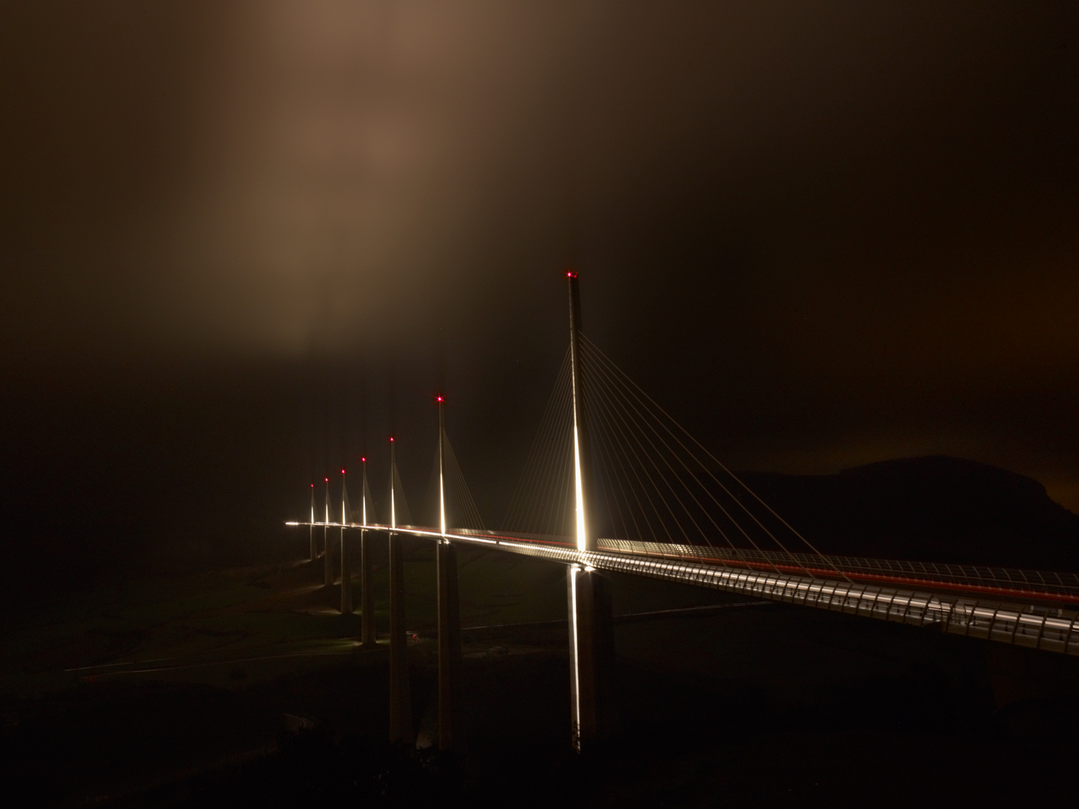 Jon Wyatt Photography - Millau Viaduct across the Tarn Valley at night in mist, France