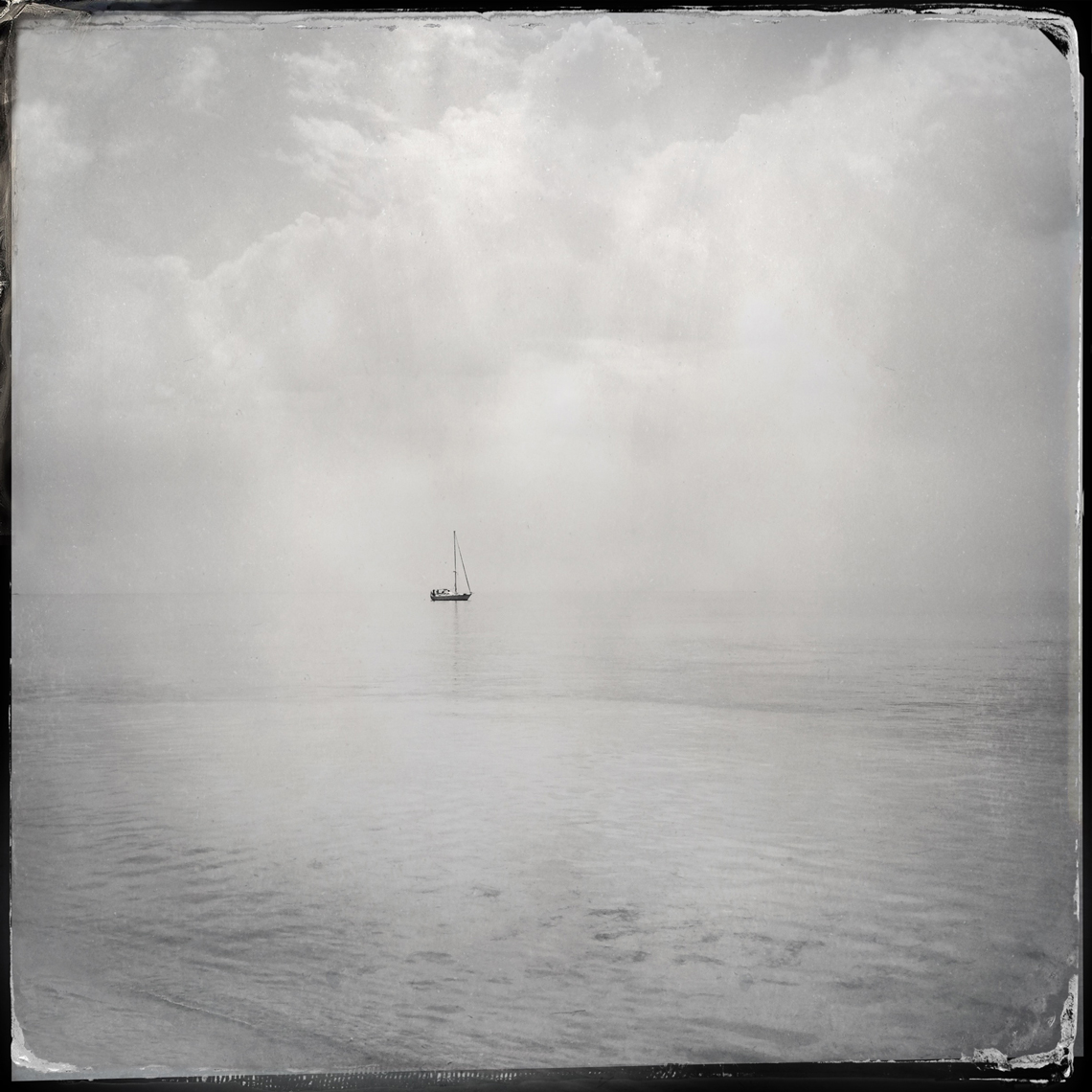 Jon Wyatt Photography - single boat at sea. Hipstamatic
