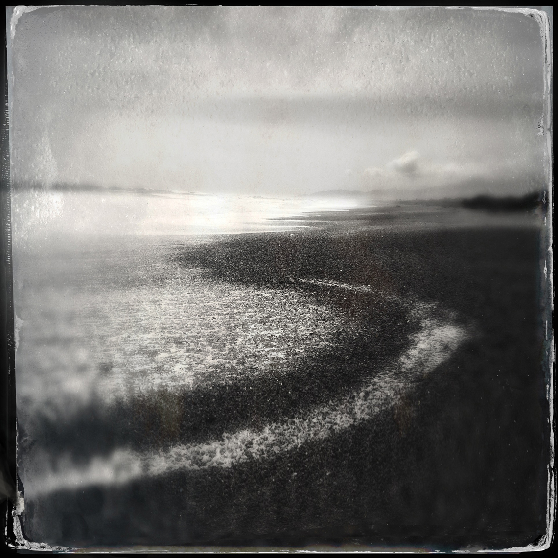 Jon Wyatt Photography - Foam and backwash, beach New Zealand. Hipstamatic