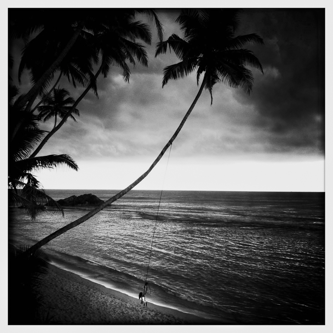 Jon Wyatt Photography - girl on swing on beach in Sri Lanka. Hipstamatic
