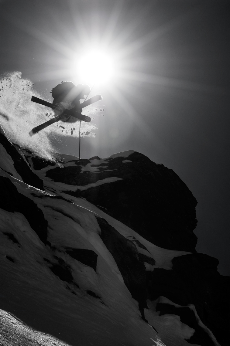 Jon Wyatt Photography - Skier jumping off cliff with sun behind