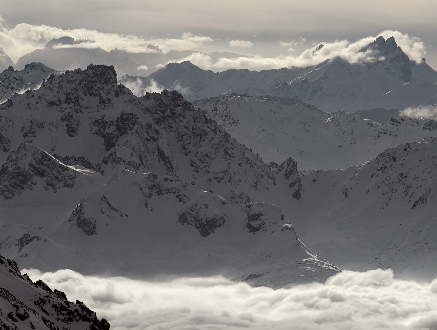 Jon Wyatt Photography - Snow-covered mountains surrounded by cloud in La Plagne backcountry, France