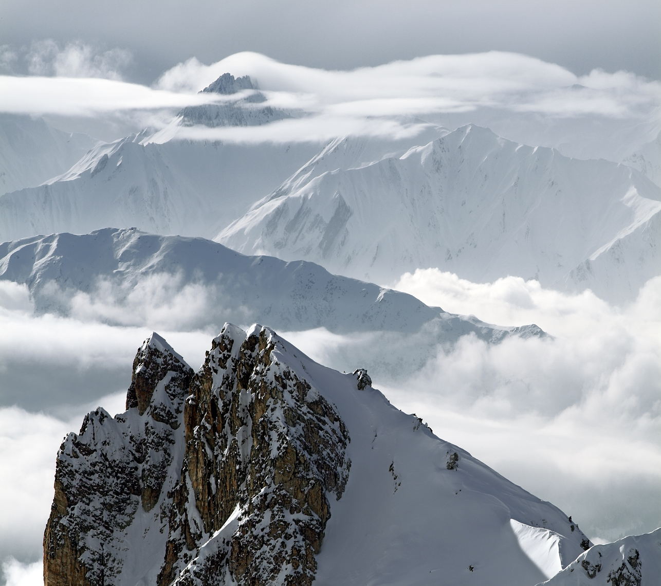 Jon Wyatt Photography - Winter Peaks surrounded by cloud in La Plagne backcountry